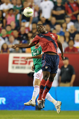 PHILADELPHIA, PA - AUGUST 10: Edson Buddle #9 of the United States heads the ball in front of Hector Moreno #15 of Mexico at Lincoln Financial Field on August 10, 2011 in Philadelphia, Pennsylvania. (Photo by Drew Hallowell/Getty Images)