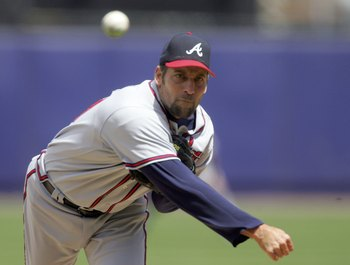 NEW YORK - MAY 07:  John Smoltz #29 of the Atlanta Braves delivers a pitch against the New York Mets on May 7, 2006 at Shea Stadium in the Flushing neighborhood of the Queens borough of New York City. The Braves defeated the Mets 13-3.  (Photo by Jim McIs