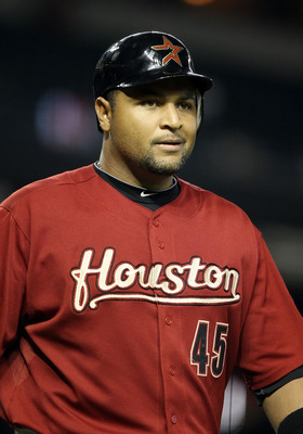 PHOENIX, AZ - AUGUST 09:  Carlos Lee #45 of the Houston Astros walks off the field after striking out against the Arizona Diamondbacks during first inning of the Major League Baseball game at Chase Field on August 9, 2011 in Phoenix, Arizona.  (Photo by C