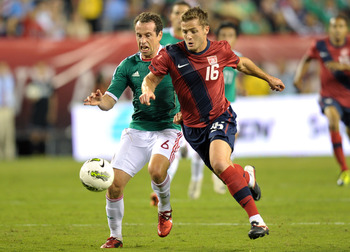 PHILADELPHIA, PA - AUGUST 10: Gerardo Torrado #6 of Mexico and Robbie Rogers #16 of the United States race for the ball at Lincoln Financial Field on August 10, 2011 in Philadelphia, Pennsylvania. The game ended 1-1. (Photo by Drew Hallowell/Getty Images)