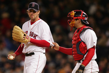 BOSTON - OCTOBER 17:  Catcher Jason Varitek #33 of the Boston Red Sox has a talk with pitcher Derek Lowe #32 of the Boston Red Sox in the fifth inning against the New York Yankees during game four of the American League Championship Series on October 17,