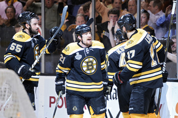 BOSTON, MA - JUNE 08:  Rich Peverley #49 of the Boston Bruins celebrates with his teammates Milan Lucic #17, Johnny Boychuk #55, David Krejci #46 and Andrew Ference #21 after scoring goal in the thrid period as Roberto Luongo #1 of the Vancouver Canucks l