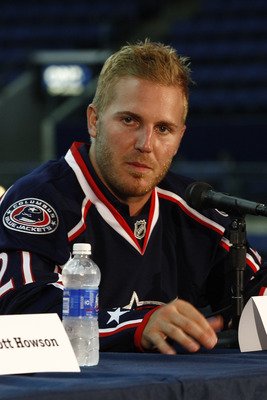 COLUMBUS,OH - JULY 21:  James Wisniewski #21 of the Columbus Blue Jackets speaks during a press conference on July 21, 2011 at Nationwide Arena in Columbus, Ohio.  (Photo by John Grieshop/Getty Images)