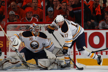 PHILADELPHIA, PA - APRIL 22:  Marc-Andre Gragnani #17 controls the puck in front of Ryan Miller #30 of the Buffalo Sabres against Philadelphia Flyers in Game Five of the Eastern Conference Quarterfinals during the 2011 NHL Stanley Cup Playoffs at Wells Fa
