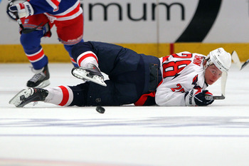 NEW YORK, NY - APRIL 20:  Alexander Semin #28 of the Washington Capitals looks back for the puck as he falls to the ice against the New York Rangers in Game Four of the Eastern Conference Quarterfinals during the 2011 NHL Stanley Cup Playoffs at Madison S