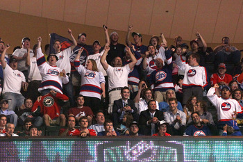 ST PAUL, MN - JUNE 24:  Winnipeg Jets hockey fans cheer on during day one of the 2011 NHL Entry Draft at Xcel Energy Center on June 24, 2011 in St Paul, Minnesota.  (Photo by Bruce Bennett/Getty Images)