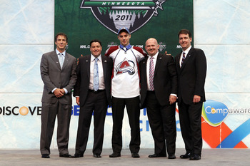 ST PAUL, MN - JUNE 24:  Eleventh overall pick Duncan Siemens by the Colorado Avalanche stands onstage for a photo with members of the Colorado Avalanche organization during day one of the 2011 NHL Entry Draft at Xcel Energy Center on June 24, 2011 in St P