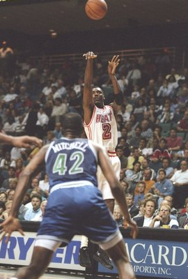 5 Mar 1996:  Guard Keith Askins of the Miami Heat shoots the ball as forward Sam Mitchell of the Minnesota Timberwolves at the Miami Arena in Miami, Florida.  The Heat won the game 113-72. Mandatory Credit: Allsport  /Allsport