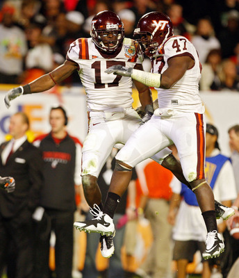 MIAMI - JANUARY 01: Kam Chancellor #17 of the Virginia Tech Hokies celebrates after making an interception with teammate Nekos Brown #47 against  the Cincinnati Bearcats the FedEx Orange Bowl at Dolphin Stadium on January 1, 2009 in Miami, Florida.  (Phot