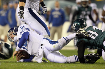 PHILADELPHIA - NOVEMBER 07:  Peyton Manning #18 of the Indianapolis Colts is sacked in the second quarter by Darryl Tapp #91 of the Philadelphia Eagles on November 7, 2010 at Lincoln Financial Field in Philadelphia, Pennsylvania.  (Photo by Jim McIsaac/Ge