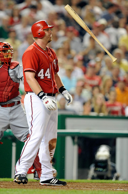WASHINGTON - JUNE 04:  Adam Dunn #44 of the Washington Nationals tosses his bat after striking out against the Cincinnati Reds at Nationals Park on June 4, 2010 in Washington, DC.  (Photo by Greg Fiume/Getty Images)
