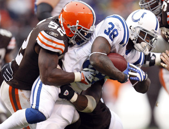 CLEVELAND - NOVEMBER 30:  Dominic Rhodes #38 of the Indianapolis Colts gets tackled by D'Qwell Jackson #52 of the Cleveland Browns during a fourth quarter run on November 30, 2008 at Cleveland Browns Stadium in Cleveland, Ohio. Indianapolis won the game 1
