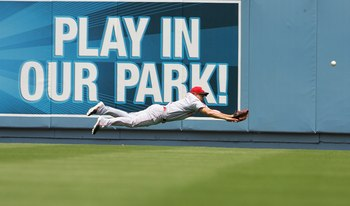LOS ANGELES - MAY 13: Ryan Freel #6 of the Cincinnati Reds leaps for the catch during the Mothers Day game against the Los Angeles Dodgers at Dodger Stadium on May 13, 2007 in Los Angeles, California. The Dodgers won 10-5. (Photo by Stephen Dunn/Getty Ima