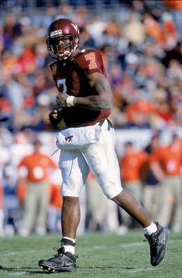 1 Jan 2001:  Quaterback Michael Vick #7of the Virginia Tech Hokies jogs on the field during the Gator Bowl Game against the Clemson Tigers at the Gator Bowl in Jacksonville, Florida.  The Hokies defeated the Tigers 41-20.Mandatory Credit: Craig Jones  /Al
