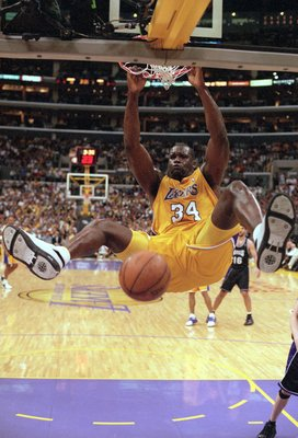8 May 2001:  Shaquille O''Neal #34 of the Los Angeles Lakers makes a slam dunk during round two of the NBA Western Conference Playoff Game against the Sacramento Kings at the STAPLES Center in Los Angeles, California. The Lakers defeated the Kings 96-90.