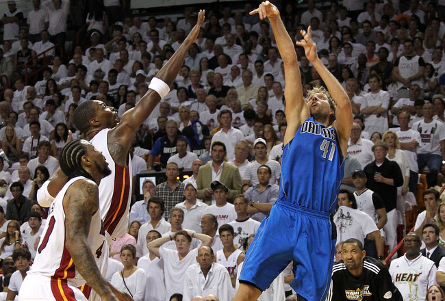 MIAMI, FL - JUNE 12:  Dirk Nowitzki #41 of the Dallas Mavericks attempts a shot against Chris Bosh #1 of the Miami Heat in Game Six of the 2011 NBA Finals at American Airlines Arena on June 12, 2011 in Miami, Florida. NOTE TO USER: User expressly acknowle