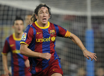BARCELONA, SPAIN - JANUARY 16:  Carles Puyol of FC Barcelona looks on during the La Liga match between FC Barcelona and Malaga at Nou Camp on January 16, 2011 in Barcelona, Spain. Barcelona won 4-1.  (Photo by David Ramos/Getty Images)