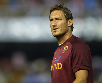 VALENCIA, SPAIN - AUGUST 12:  Totti of Roma looks on before the start of the Orange Trophy match between Valencia and Roma at Estadio Mestalla on August 12, 2011 in Valencia, Spain.  (Photo by Manuel Queimadelos Alonso/Getty Images)