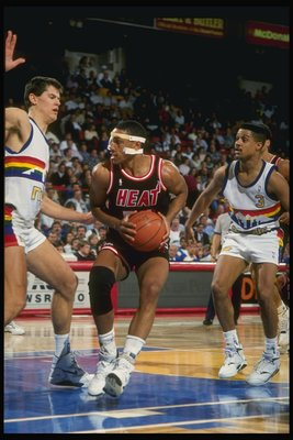 1989:  Guard Kevin Edwards of the Miami Heat (center) drives the ball past center Blair Rasmussen (left) and guard Chris Jackson of the Denver Nuggets during a game at the McNichols Arena in Denver, Colorado. Mandatory Credit: Tim de Frisco  /Allsport