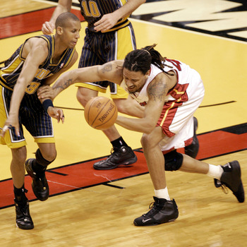 MIAMI - MAY 12:  Reggie Miller #31 of the Indiana Pacers and Brian Grant #44 of the Miami Heat go for a loose ball in the first quarter in Game Four of the Eastern Conference Semifinals during the 2004 NBA Playoffs May 12, 2004 at the American Airlines Ar