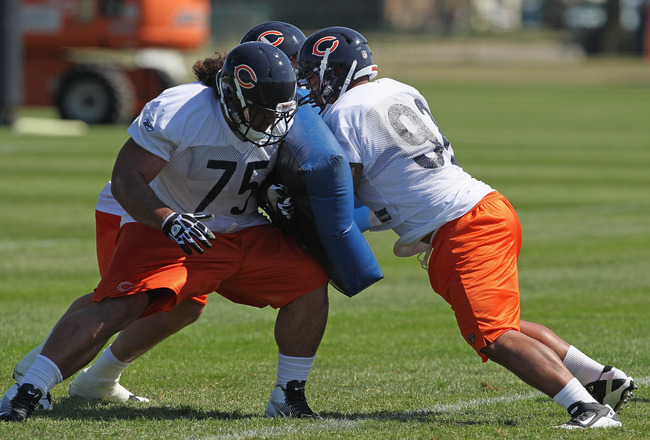 BOURBONNAIS, IL - JULY 30:  Stephen Paea #92 of the Chicago Bears rushes between Sean Murnane #70 and Matt Toeaina #75 (L) during a summer training camp practice at Olivet Nazarene University on July 30, 2011 in Bourbonnais, Illinois.  (Photo by Jonathan