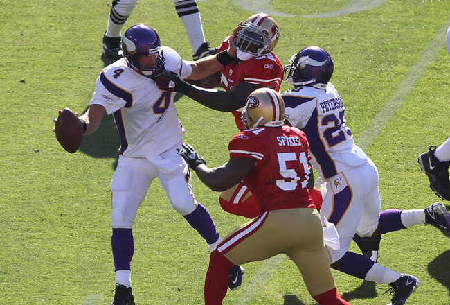 SAN FRANCISCO - AUGUST 22:  Brett Favre #4 of the Minnesota Vikings is pressured by Patrick Willis #52 and Takeo Spikes #51 of the San Francisco 49ers during an NFL pre-season game at Candlestick Park on August 22, 2010 in San Francisco, California.  (Pho