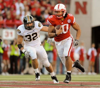 LINCOLN, NE - OCTOBER 30: Running back Roy Helu Jr. #10 of the Nebraska Cornhuskers gets chased by linebacker Will Ebner #32 of the Missouri Tigers during second half action of their game at Memorial Stadium on October 30, 2010 in Lincoln, Nebraska. Nebra