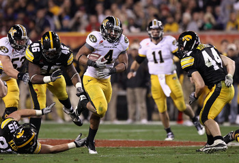 TEMPE, AZ - DECEMBER 28:  Tailback Kendial Lawrence #4 of the Missouri Tigers runs with the football against the Iowa Hawkeyes during the Insight Bowl at Sun Devil Stadium on December 28, 2010 in Tempe, Arizona.  (Photo by Christian Petersen/Getty Images)