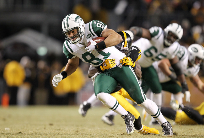 PITTSBURGH, PA - JANUARY 23:  Dustin Keller #81 of the New York Jets is tackled by Lawrence Timmons #94 of the Pittsburgh Steelers during the 2011 AFC Championship game at Heinz Field on January 23, 2011 in Pittsburgh, Pennsylvania.  (Photo by Ronald Mart