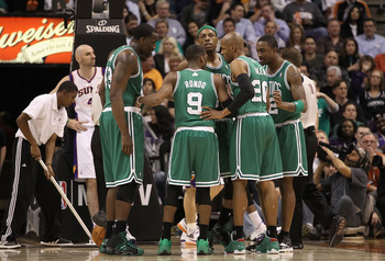 PHOENIX, AZ - JANUARY 28:  Kendrick Perkins #43, Rajon Rondo #9, Paul Pierce #34, Ray Allen #20 and Von Wafer #12 of the Boston Celtics huddle up during the NBA game against the Phoenix Suns at US Airways Center on January 28, 2011 in Phoenix, Arizona. Th