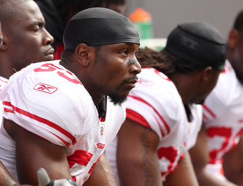 SEATTLE - SEPTEMBER 12:  Linebacker NaVorro Bowman #53 of the San Francisco 49ers looks on from the bench during the NFL season opener against the Seattle Seahawks at Qwest Field on September 12, 2010 in Seattle, Washington. (Photo by Otto Greule Jr/Getty