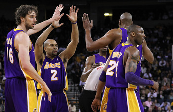 OAKLAND, CA - MARCH 15: Derek Fisher #2 of the Los Angeles Lakers celebrates with teammates against the Golden State Warriors during an NBA game at Oracle Arena on March 15, 2010 in Oakland, California.   NOTE TO USER: User expressly acknowledges and agre