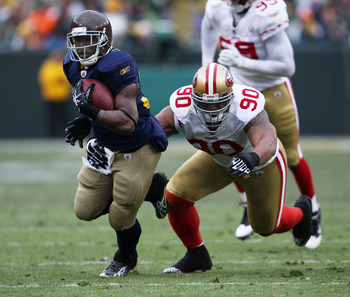 GREEN BAY, WI - DECEMBER 05: Brandon Jackson #32 of the Green Bay Packers breaks away from Isaac Sopoaga #90 of the San Francisco 49ers at Lambeau Field on December 5, 2010 in Green Bay, Wisconsin. The Packers defeated the 49ers 34-16. (Photo by Jonathan
