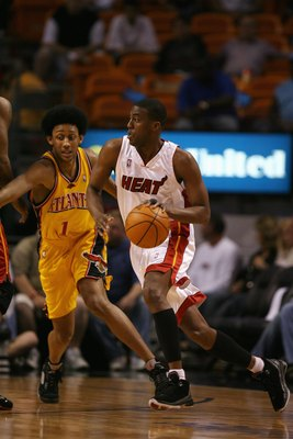 MIAMI - MARCH 26:  Eddie Jones #6 of the Miami Heat drives around Josh Childress #1 of the Atlanta Hawks during the game at American Airlines Arena on March 26, 2007 in Miami, Florida. The Heat won 106-89. NOTE TO USER: User expressly acknowledges and agr