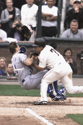 SAN FRANCISCO - OCTOBER 7:  Marvin Benard #7 of the San Francisco Giants collides with catcher Chad Kreuter #21 of the Los Angeles Dodgers and is tagged out during the game on October 7, 2001 at Pac Bell Park in San Francisco, California.  The Giants won