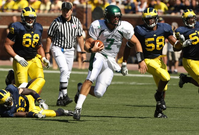 ANN ARBOR, MI - SEPTEMBER 19:  Quarterback Andy Schmitt #7 of the Eastern Michigan Eagles carries the ball against the Michigan Wolverines  at Michigan Stadium on September 19, 2009 in Ann Arbor, Michigan.  Michigan won 45-17.  (Photo by Stephen Dunn/Gett