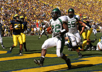 ANN ARBOR, MI - SEPTEMBER 19: Running back Dwayne Priest #22 of the Eastern Michigan Eagles celebrates as he scores on a  five yard touchdown run in the second quarter against the Michigan Wolverines  at Michigan Stadium on September 19, 2009 in Ann Arbor