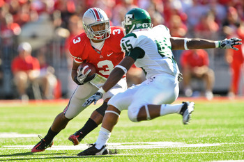 COLUMBUS, OH - SEPTEMBER 25:  Brandon Saine #3 of the Ohio State Buckeyes runs with the ball against Matt Boyd #45 of the Eastern Michigan Eagles at Ohio Stadium on September 25, 2010 in Columbus, Ohio.  Ohio State won 73-20. (Photo by Jamie Sabau/Getty I