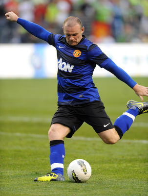 SEATTLE, WA - JULY 20: Wayne Rooney #10 of Manchester United kicks the ball for a goal during the second half of the game against the Seattle Sounders FC at CenturyLink Field on July 20, 2011 in Seattle, Washington. Manchester United won the game 7-0. (Ph