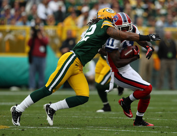GREEN BAY, WI - SEPTEMBER 19: Roscoe Parrish #11 of the Buffalo Bills is hit by Morgan Burnett #42 of the Green Bay Packers after catching a pass at Lambeau Field on September 19, 2010 in Green Bay, Wisconsin. The Packers defeated the Bills 34-7.  (Photo
