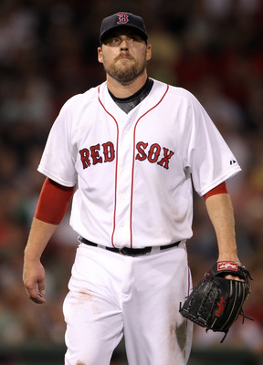 BOSTON, MA - AUGUST 01:  John Lackey #41 of the Boston Red Sox reacts on his way to the dugout after the sixth inning against the Cleveland Indians on August 1, 2011 at Fenway Park in Boston, Massachusetts.  (Photo by Elsa/Getty Images)