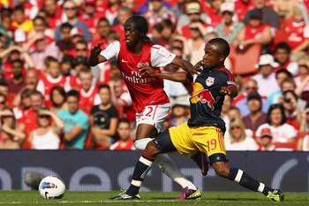 LONDON, ENGLAND - JULY 31:  Gervinho of Arsenal holds off the challenge by Dane Richards of New York Red Bulls during the Emirates Cup match between Arsenal and New York Red Bulls at the Emirates Stadium on July 31, 2011 in London, England.  (Photo by Ric