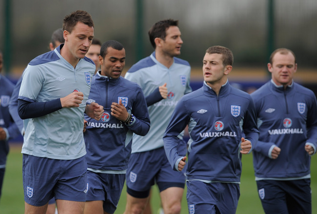 ST ALBANS, ENGLAND - MARCH 22:  John Terry warms up with team mates Ashley Cole, Frank Lampard, Jack Wilshere and Wayne Rooney during the England training session ahead of their UEFA EURO 2012 qualifier against Wales, at London Colney on March 22, 2011 in