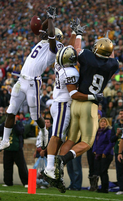 SOUTH BEND, IN - OCTOBER 03: Desmond Trufant #6 of the Washington Huskies breaks up a pass intended for Kyle Rudolph #9 of the Notre Dame Fighting Irish as teammate Justin Glenn #20 also defends on October 3, 2009 at Notre Dame Stadium in South Bend, Indi