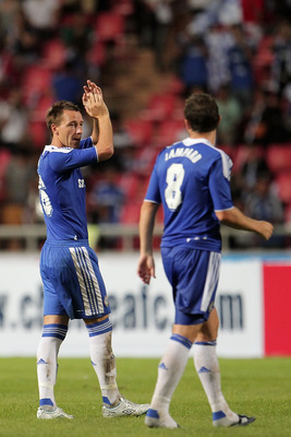 BANGKOK, THAILAND - JULY 24: John Terry #26 of Chelsea and team mate Frank Lampard wave to the crowd during the pre-season friendly match between the Thailand All Stars and Chelsea at Rajamangala National Stadium on July 24, 2011 in Bangkok, Thailand.  (P