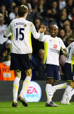 LONDON, ENGLAND - NOVEMBER 22:  Jermain Defoe of Tottenham Hotspur celebrates his fifth goal with Peter Crouch during the Barclays Premier League match between Tottenham Hotspur and Wigan Athletic at White Hart Lane on November 22, 2009 in London, England