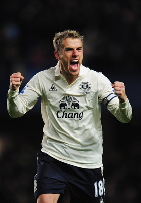 LONDON, ENGLAND - DECEMBER 04:  Phil Neville of Everton celebrates as Jermaine Beckford scores their first goal during the Barclays Premier League match between Chelsea and Everton at Stamford Bridge on December 4, 2010 in London, England.  (Photo by Shau