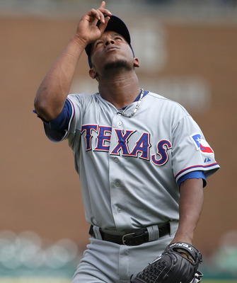 DETROIT - AUGUST 04:  Neftali Feliz #30 of the Texas Rangers celebrates a 5-2 win over the Detroit Tigers at Comerica Park on August 4, 2011 in Detroit, Michigan. (Photo by Leon Halip/Getty Images)