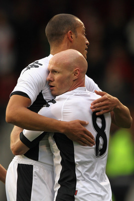 LONDON, ENGLAND - JULY 21:  Bobby Zamora of Fulham celebrates with scorer Andrew Johnson after he scores the opening goal during the UEFA Europa League 2nd Qualifying Round 2nd Leg match between Fulham and Crusaders at Craven Cottage on July 21, 2011 in L