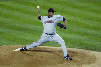 ANAHEIM, CA - OCTOBER 27:  Livan Hernandez #61 of the San Francisco Giants throws against the Anaheim Angels in game seven of the World Series on October 27, 2002 at Edison Field in Anaheim, California.  The Angels won the game 4-1 and the Series 4-3.  (P